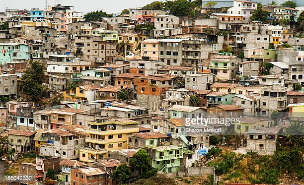 View over a crowded neighbourhood on a hillside of Guayaquil, Ecuador with houses and apartments in varying colours