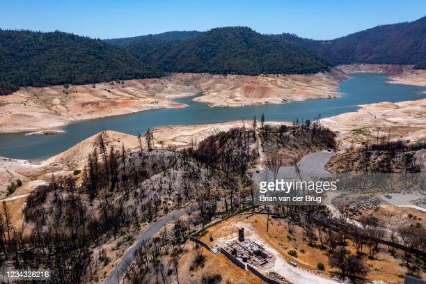 View over a home burned in the North Complex Fire in 2020, towards the Enterprise area boat ramp on Lake Oroville, which stands at 33 percent full...
