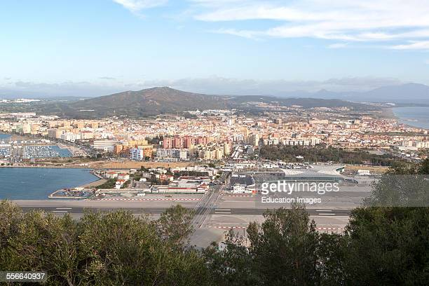 View over airport runway to Spanish town of La Linea from Gibraltar British overseas territory in southern Europe