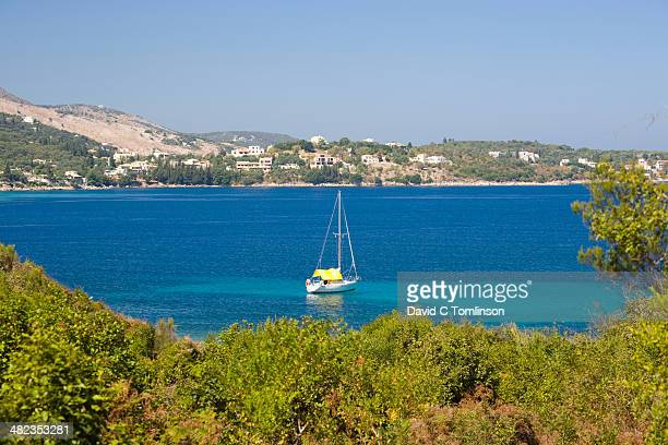 view over avlaki bay, kassiopi, corfu, greece - corfu stock pictures, royalty-free photos & images