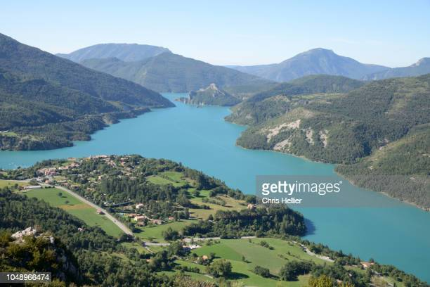view over castillon lake and village of saint-julien-du-verdon - reservoir stock pictures, royalty-free photos & images