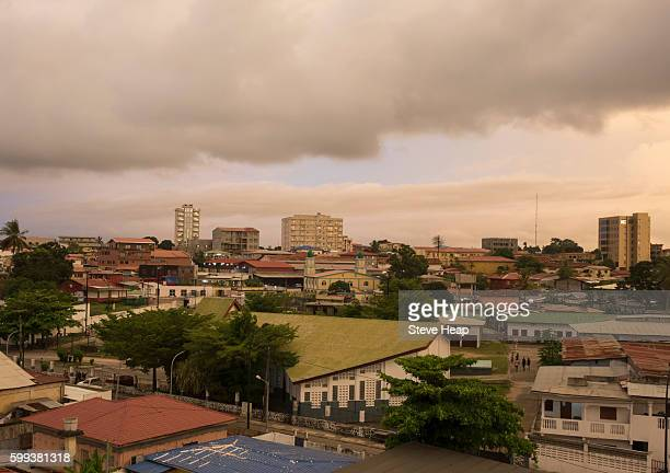 view over city and town roofs at sunset in bata, equatorial guinea - equatorial guinea stock pictures, royalty-free photos & images