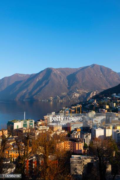 View over City Paradiso and Alpine Lake Lugano with Mountain