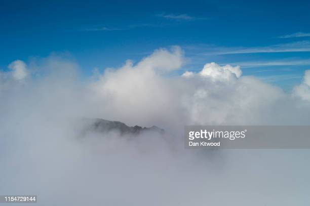 View over clouds from the summit of Mount Snowdon, in Snowdonia National Park on June 24, 2019 North Wales.