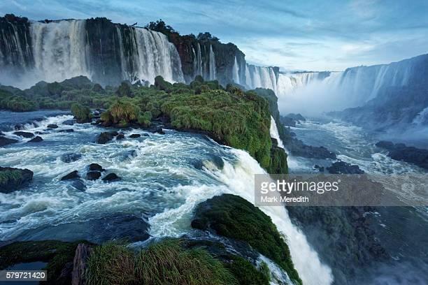 View over edge of Santa Maria Falls at the end of the walkway beneath Floriano Falls at Iguazu Falls