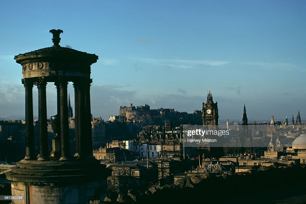 A view over Edinburgh, Scotland, UK, from Calton Hill, with the Dugald Stewart Monument in the foreground and Edinburgh Castle in the background, 1970.