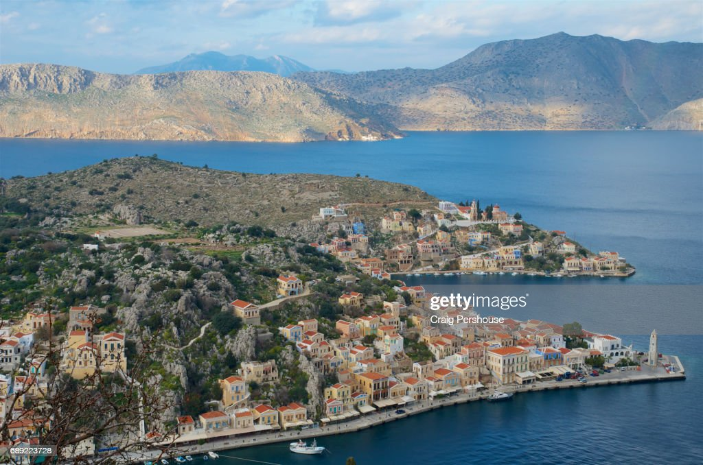 View over Gialos, Symi Harbour and Kokkinohama Bay from Horio. : Stock Photo