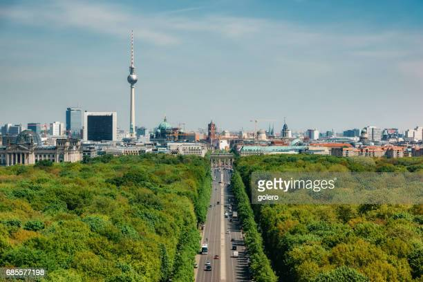 view over green Tiergarten Park on Berlin Skyline with Tv-Tower under blue sky