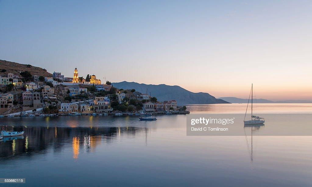 View over Harani Bay, dawn, Gialos, Symi, Greece : Foto stock