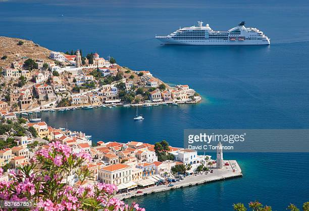 view over harani bay, gialos, symi, greece - cruise ship stock pictures, royalty-free photos & images
