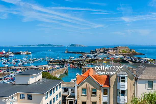 view over harbor of saint peter port guernsey - isola di guernsey foto e immagini stock
