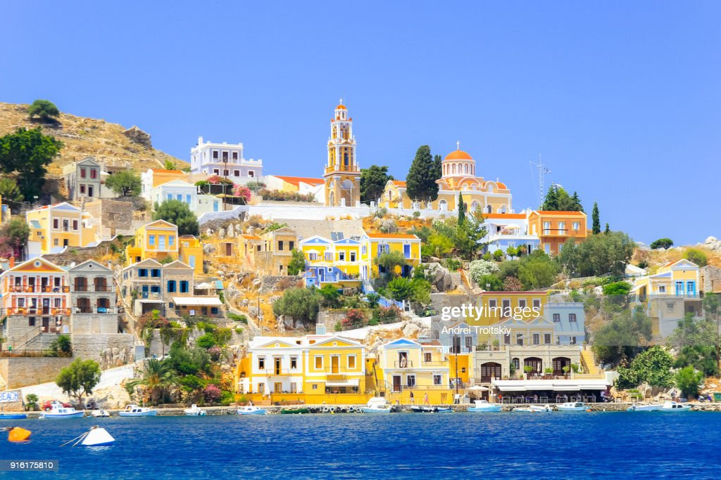 View over harbour to colourful houses and church, Symi, Dodecanese Islands, South Aegean, Greece : Stock Photo