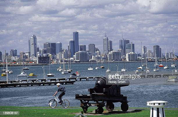 View over Hobson Bay to city skyline from Williamstown, cannon in f/g, Melbourne, Vic, Australia (1999)