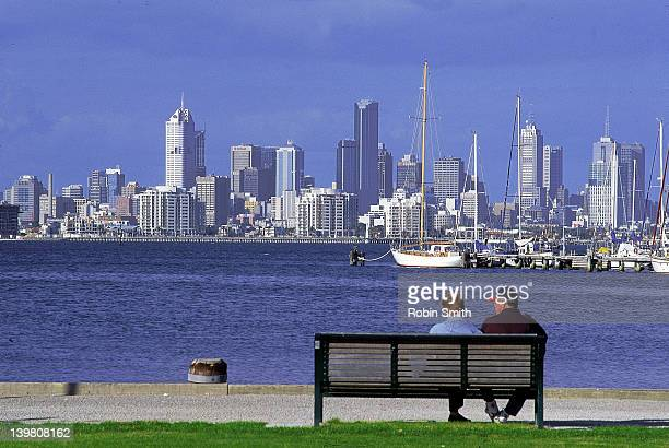 View over Hobson Bay to city skyline from Williamstown, couple in f/g, Melbourne, Vic, Australia (1999)