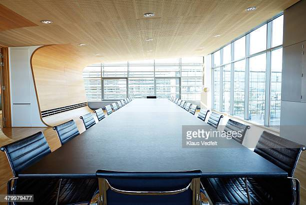 view over huge table in designed meeting room - tavolo da conferenza foto e immagini stock