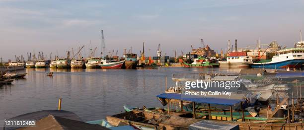 view over jakarta's historic harbour - collin key stock-fotos und bilder
