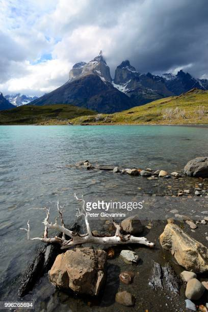 View over Lake Pehoe to the mountains Los Cuernos with clouds, National Park Torres del Paine, Province Ultima Esperanza, Chile