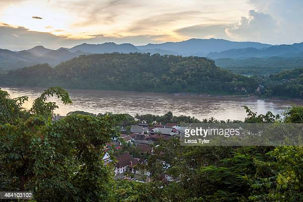 View over Luang Prabang and the Mekong River from Mount Phousi a 100m high hill with a Buddhist temple in the centre of the old town of Luang Prabang...