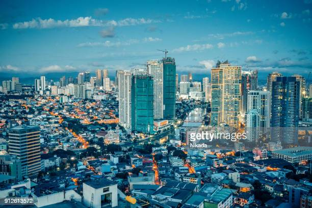 view over makati skyline at dusk, metro manila - philippines - makati stock photos and pictures