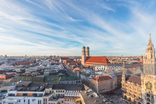 view over munich. munich skyline with marienplatz in munich with old town hall and frauenkirche. - münchen stock-fotos und bilder