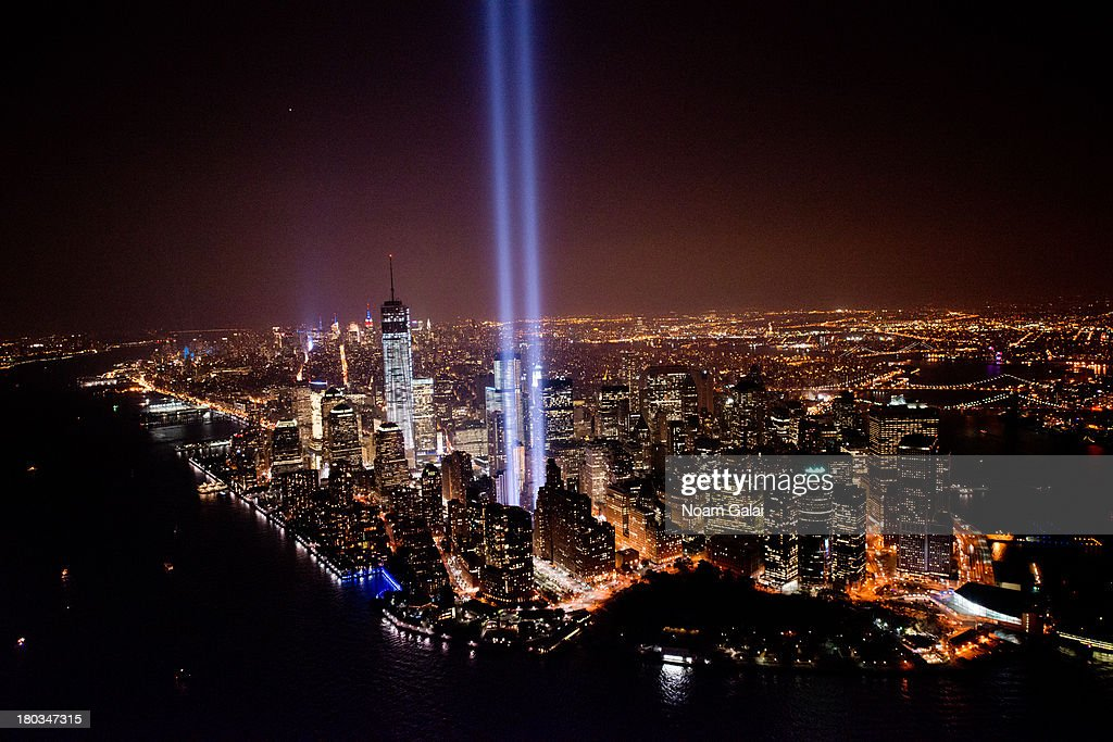 A view over New York City and the 'Tribute In Light' marking the twelfth anniversary of the terrorist attacks at the World Trade Center on September 11, 2013 in New York City. New York City and the nation are commemorating the twelfth anniversary of the September 11, 2001 attacks which resulted in the deaths of nearly 3,000 people after two hijacked planes crashed into the World Trade Center, one into the Pentagon in Arlington, Virginia and one crash landed in Shanksville, Pennsylvania.