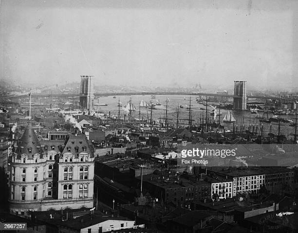 A view over New York from the Produce Exchange including Brooklyn Bridge and trade activity on the river