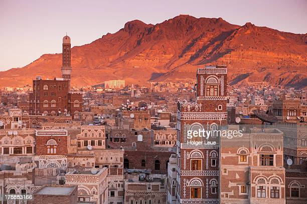 view over old town sana'a rooftops at sunset - sanaa stock pictures, royalty-free photos & images