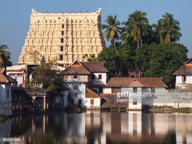 view over pond on gopuram of sree padmanabhaswamy temple in thiruvananthapuram (aka trivandrum), kerala, india - temple building stock pictures, royalty-free photos & images