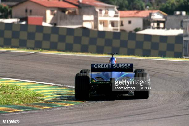 A view over Sao Paulo is visible as Sauber's Kimi Raikkonen takes a corner