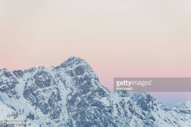 view over snowy mountains with evening sky at dusk, saalbach hinterglemm, pinzgau, austria - ski resort stock pictures, royalty-free photos & images