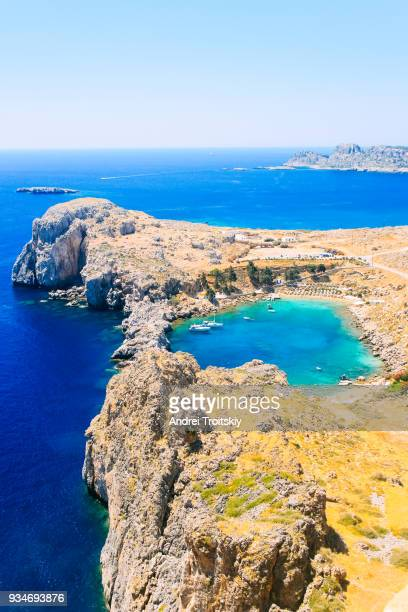 view over st. paul's bay, lindos, rhodes - lindos stock photos and pictures