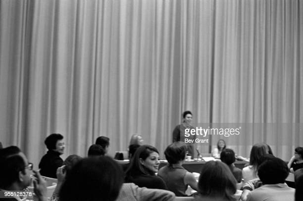 View over the audience in the Time Life Building auditorium as a panel speaker stands during an employeeorganized meeting to support the Moratorium...