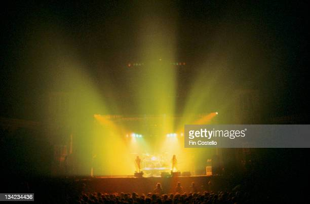 A view over the audience towards the stage at a concert by Canadian progressive rock band Rush circa 1985