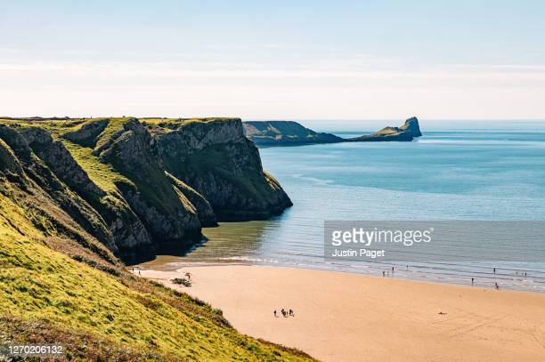 view over the beach in rhossili bay - beach stock pictures, royalty-free photos & images