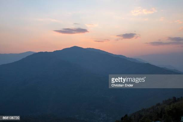 View over the beautiful mountains to the Himalayas in Kalimpong while sunset
