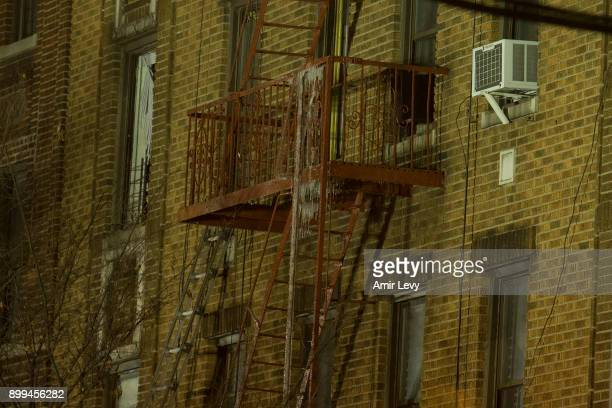A view over the building were a major house fire on Prospect avenue on December 28 2017 in the Bronx borough of New York City Over 170 firefighters...