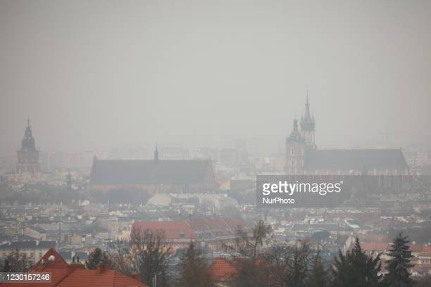 View over the city of Krakow and St. Mary's Basilica from Krakus Mound during smog standards many times exceeded. Krakow, Poland on December 16, 2020.