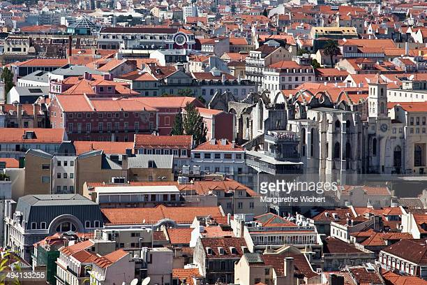 View over the city of Lisbon with the ruins of the Gothic church of the former Carmo Convent which was ruined in the 1755 Lisbon Earthquake on...