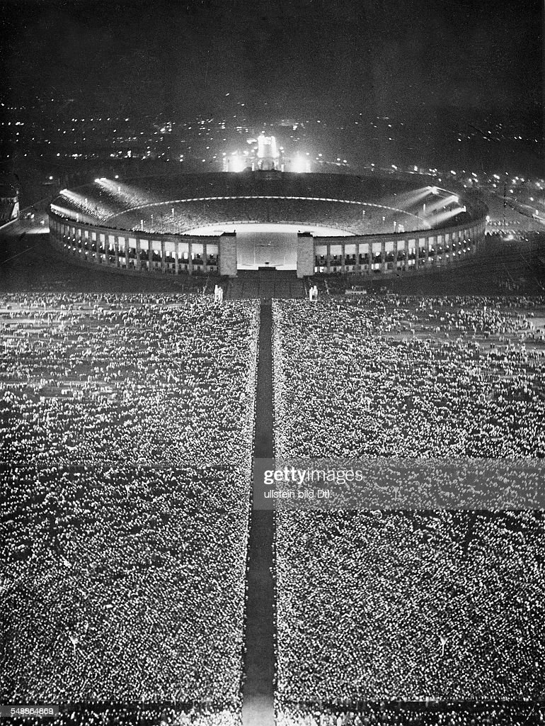 view over the crowd on the maifeld and in the olympic stadion in