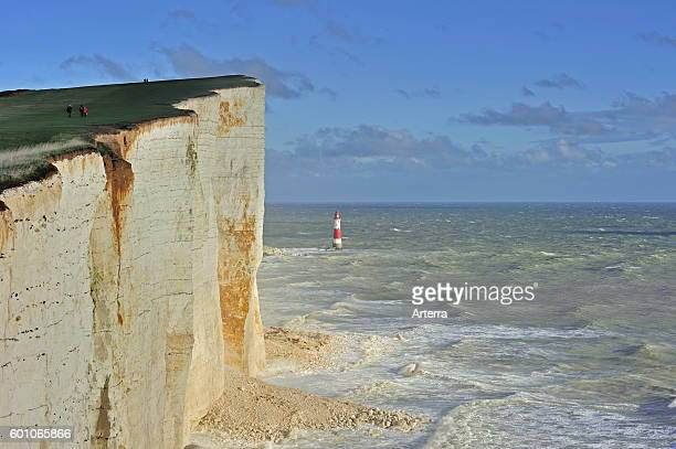 View over the eroded white chalk cliffs and lighthouse at Beachy Head Sussex in Southern England UK