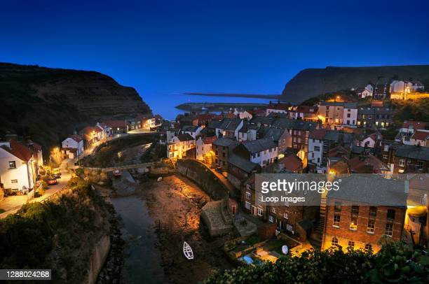 View over the fishing village of Staithes at dusk in the North York Moors National Park.