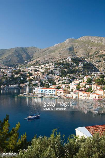 view over the harbour from hillside, gialos, symi - symi stock photos and pictures