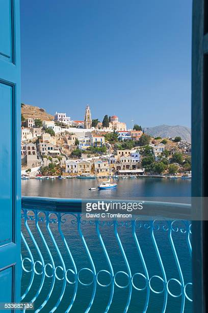 view over the harbour, gialos, symi, greece - symi stock photos and pictures
