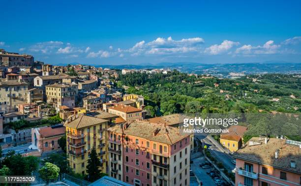 view over the hilly countryside from the eastern hilltop bastions of the umbrian capital perugia in central italy, june 30, 2018 - ペルージャ市 ストックフォトと画像