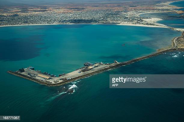 A view over the Kismayo seaport as ships load with charcoal in Somalia on March 15 2013 Kismayo has been fought over by multiple groups for over 20...