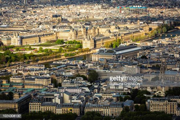 view over the louvre, orsay museum, the seine, and centre pompidou museum at sunset in paris, france. - centre pompidou stock pictures, royalty-free photos & images