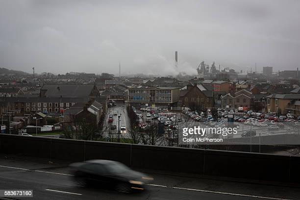 View over the M4 motorway in the centre of the town of Port Talbot, south Wales with the steelworks in the distance. Port Talbot. Tata Steel, the...