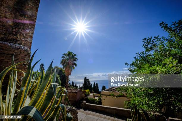 view over the mediterranian from the stairs of the greek theater in taormina, sicily - finn bjurvoll stockfoto's en -beelden