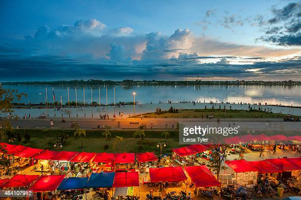 A view over the Mekong River and night market at the riverside in the Laos capital Vientiane The river at this point on its journey to the sea...