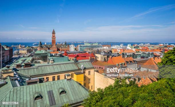 view over the roofs of the baltic sea coastal city of helsingborg, scania, sweden - helsingborg stock pictures, royalty-free photos & images